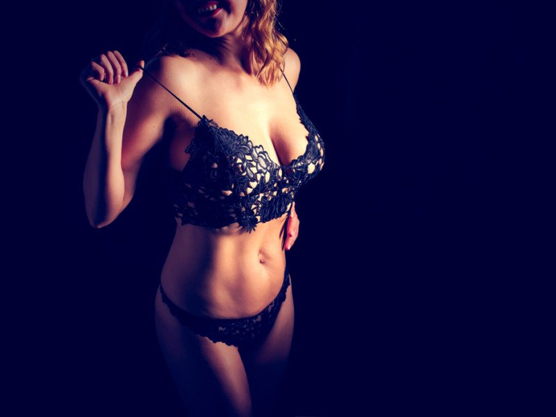 Adult woman in black lace lingerie