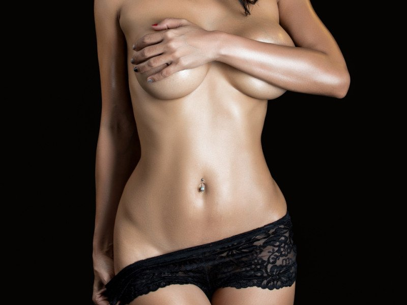 Sexy woman body isolated on black